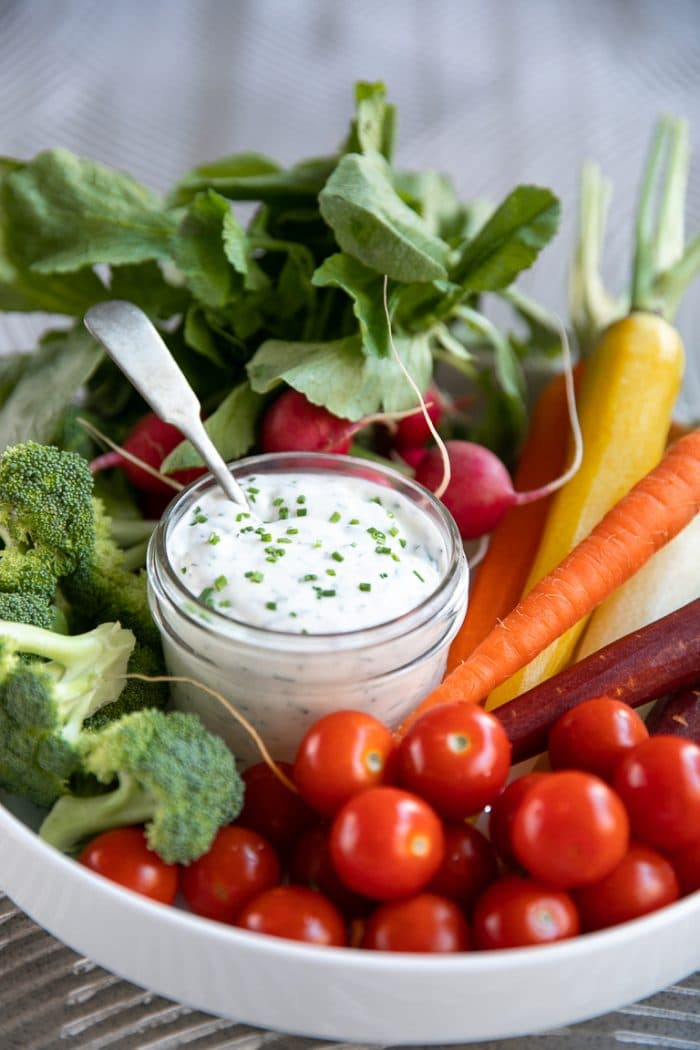 Platter filled with vegetables and served with a small mason jar filled with homemade ranch dressing.