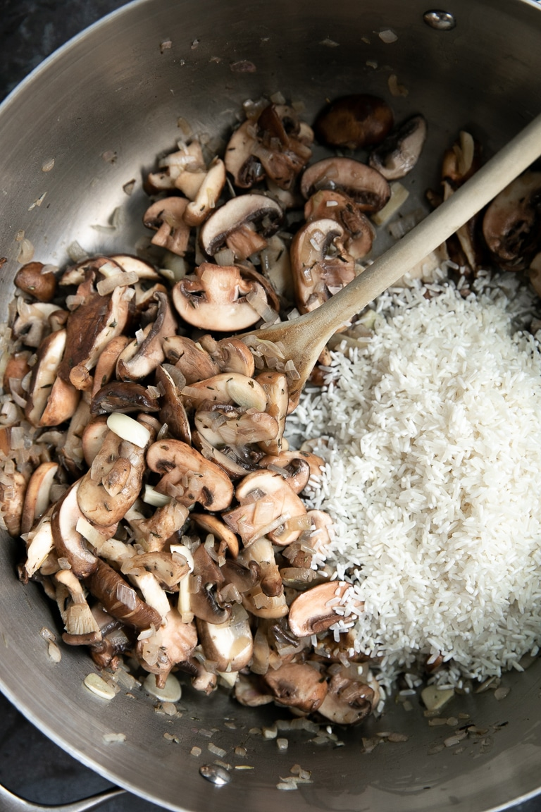 A pan of food with Mushroom and Rice Pilaf
