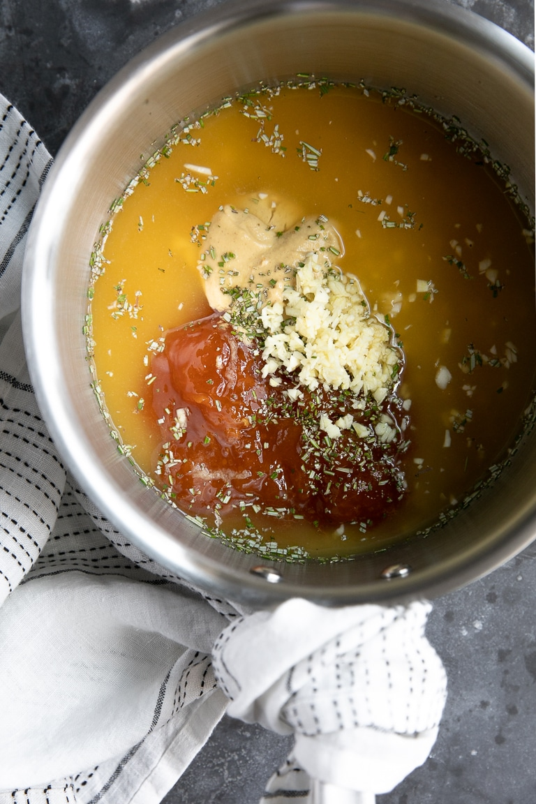 A pot of ham glaze ingredients being mixed