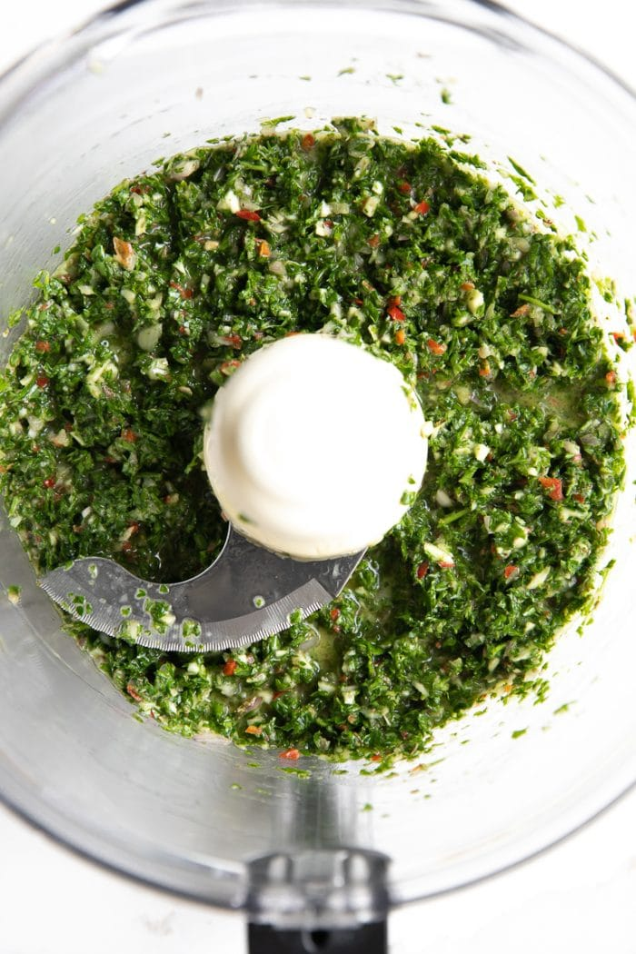 blended parsley, garlic, red wine vinegar, oregano for Chimichurri in food processor