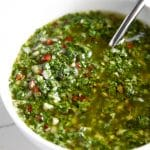 A close up of a bowl Chimichurri