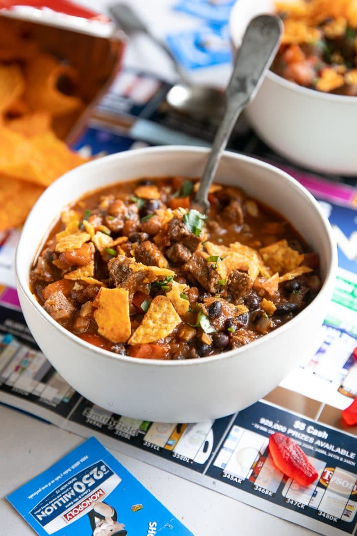 Steak chili filled with black beans, red bell pepper, and topped with nacho doritos.