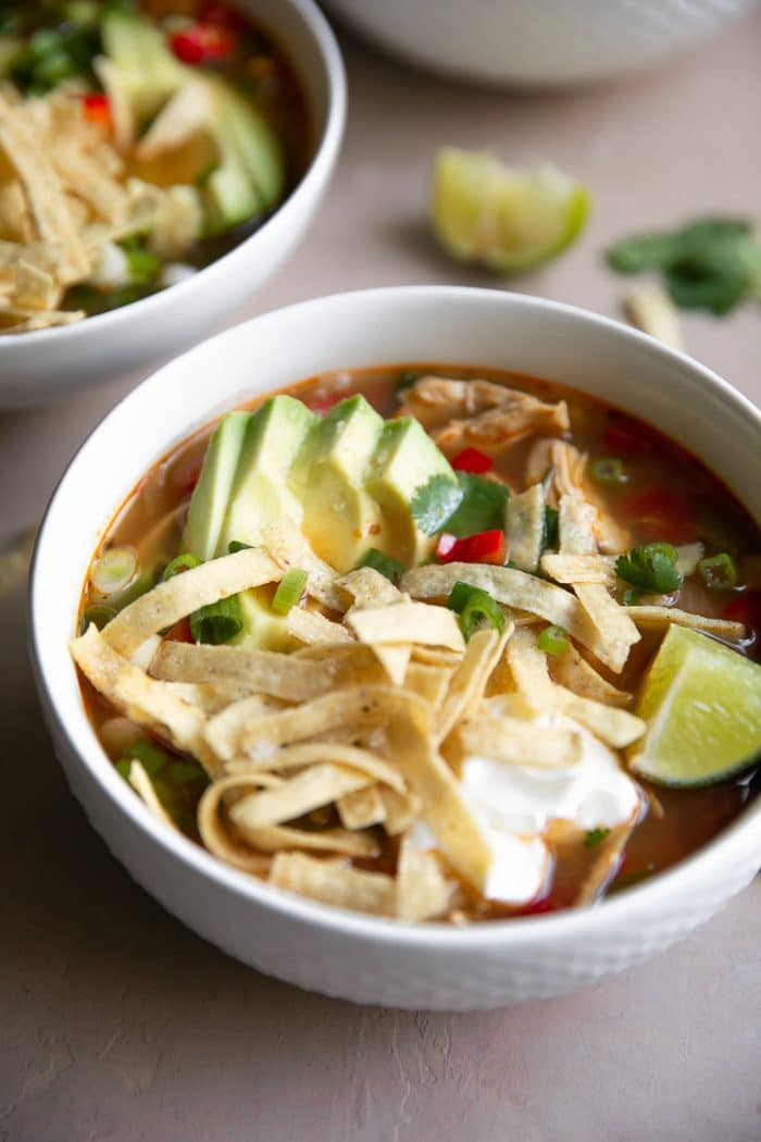 Close-up image of a bowl filled with chicken tortilla soup.