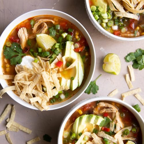A bowl of Chicken Tortilla Soup on a table