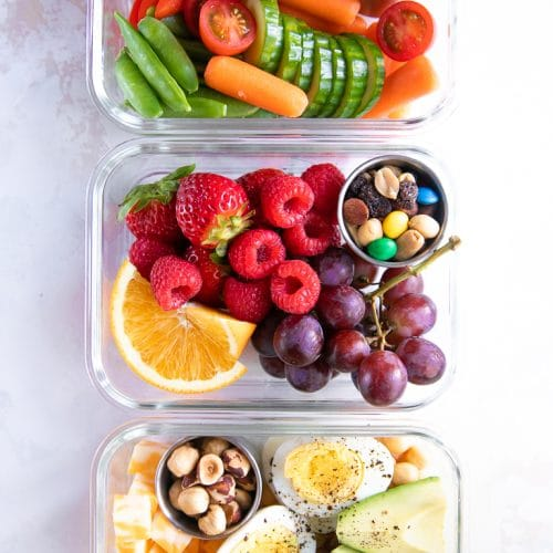 A meal prep container filled with different types of healthy snack foods
