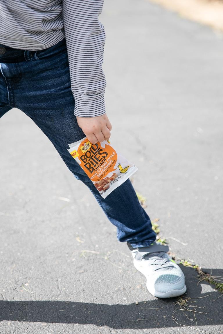 a boy holding a snack