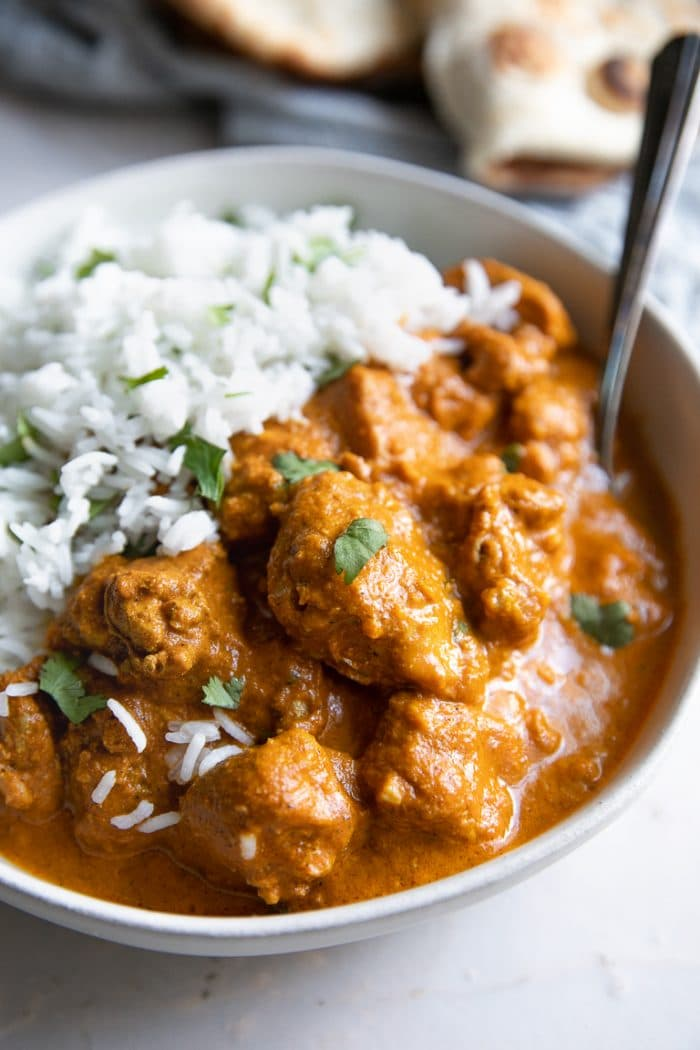 RIce and creamy Chicken Tikka Masala served with white rice.