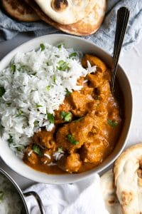 A bowl of chicken tikka masala with rice