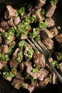 A close up of chimichurri steak bites