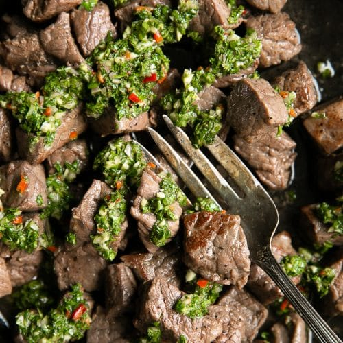 A close up of chimichurri steak bites
