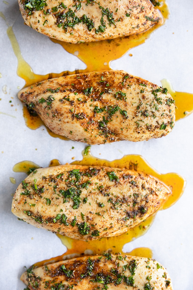 two cooked chicken breast with chicken juice dripping