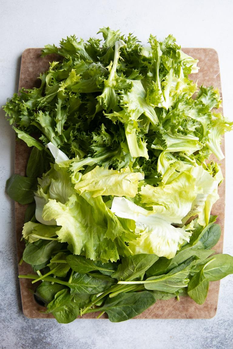 Fresh greens on cutting board for Italian Wedding Soup