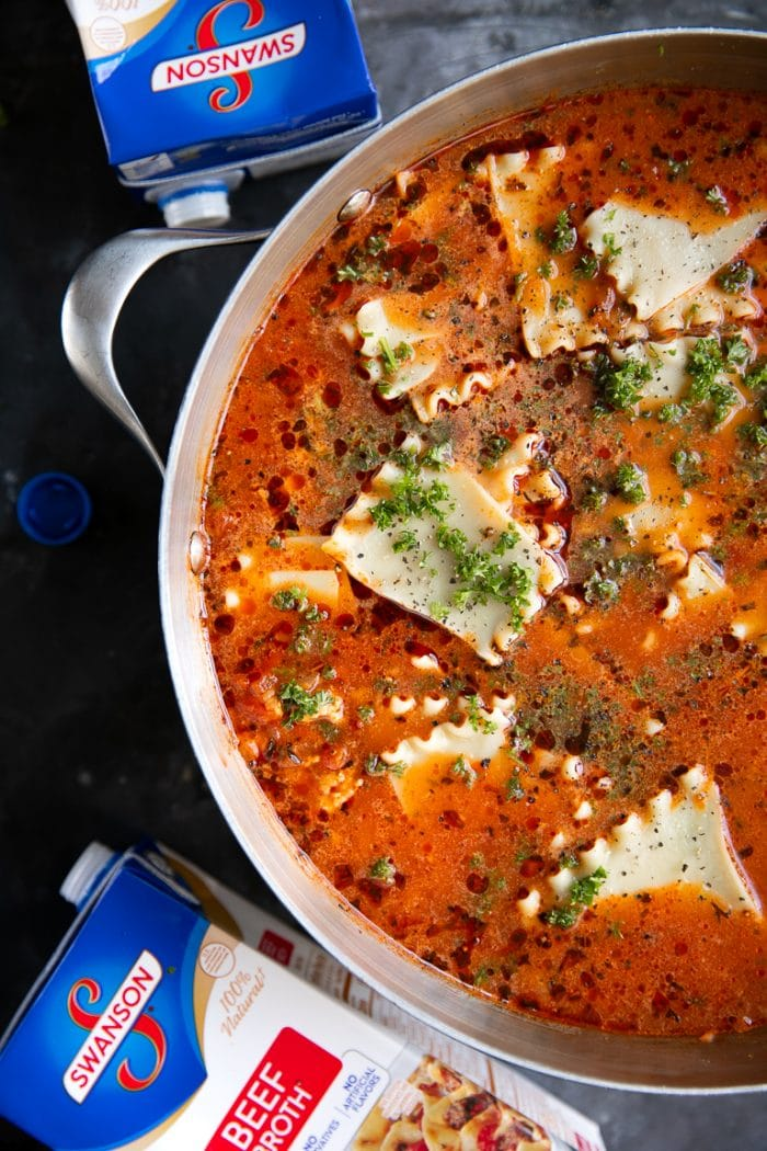 Large pot filled with lasagna soup and sprinkled with fresh parsley.