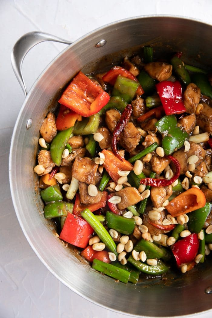 Overhead image of a large pot filled with Kung Pao Chicken.