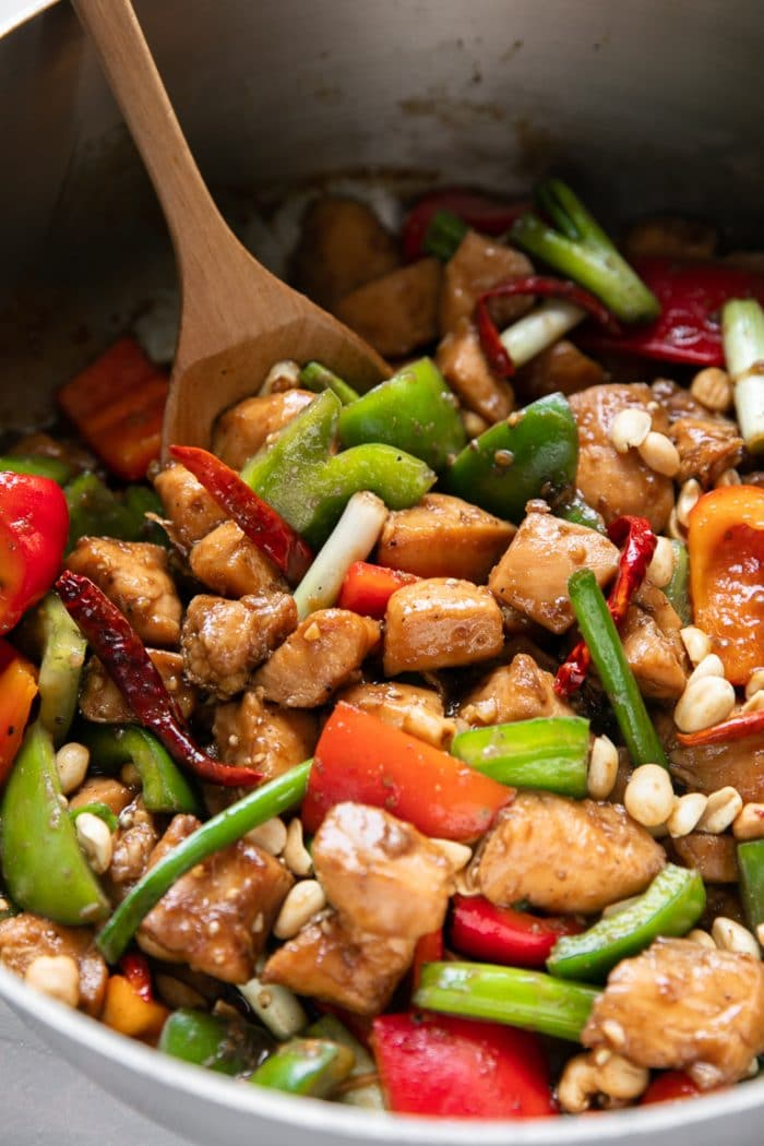 Large pan filled with Kung Pao Chicken made with red and green bell peppers in a sweet and tangy kung pao sauce.