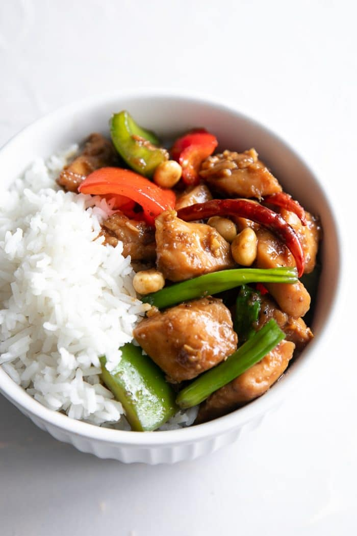 Close-up image of Kung Pao Chicken with a side of white rice.