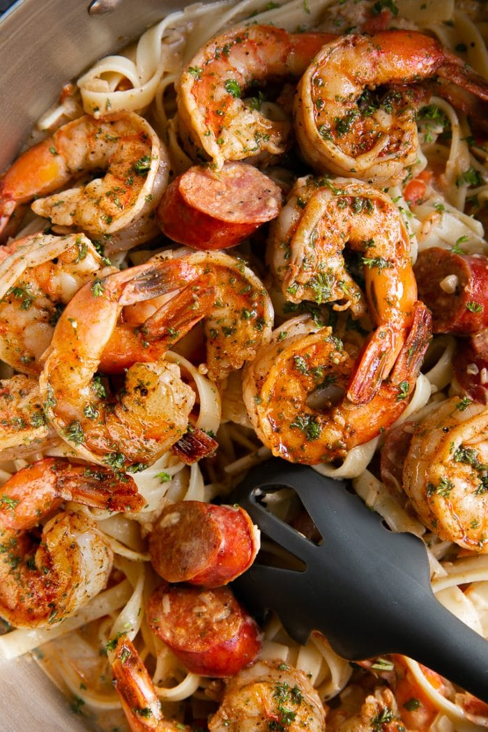 Overhead image of Cajun shrimp with creamy pasta.