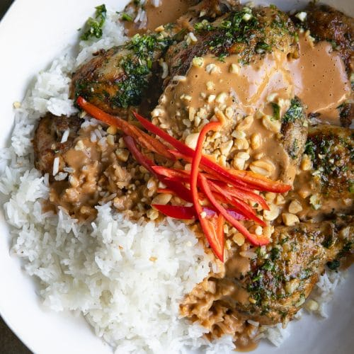 A plate of food with rice and Grilled Thai Peanut Chicken