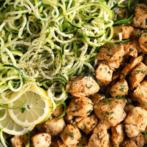 A bowl of food with zoodles, with Garlic Butter Chicken