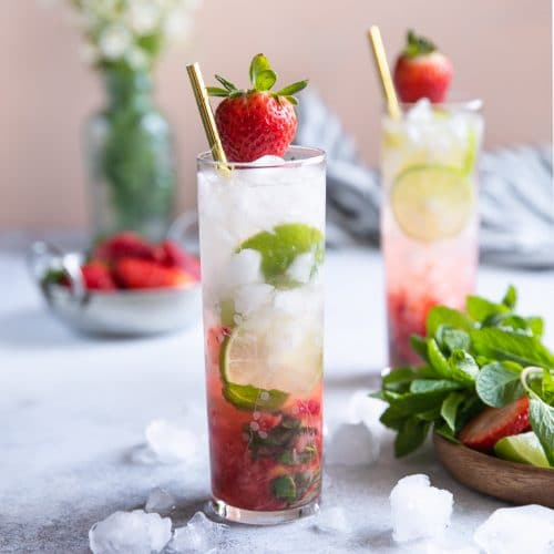 A close up of a strawberry mojito