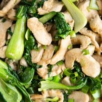 Overhead image of chicken and bok choy stir fried in a light sauce.