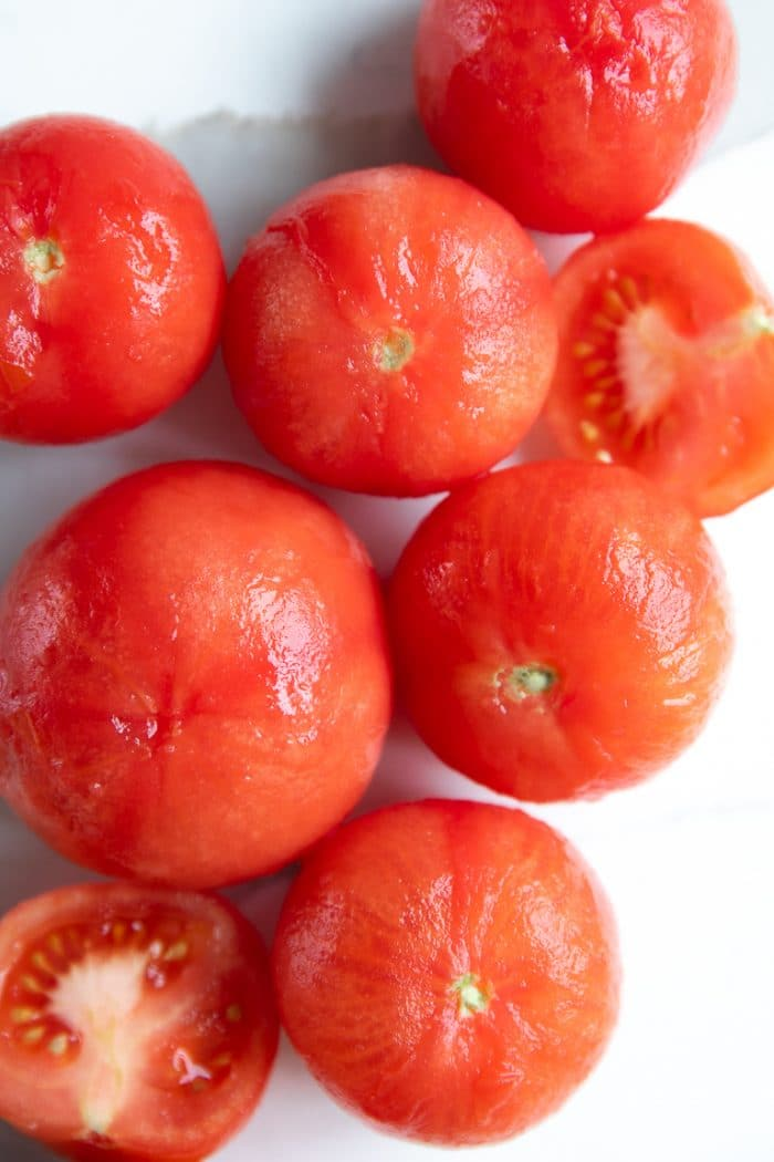 Image of peeled vine-ripened tomatoes.