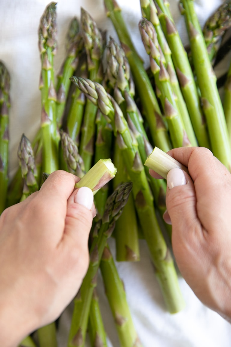 Snapping off the ends of as asparagus.