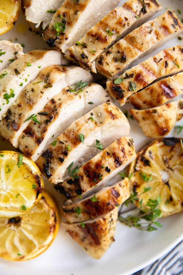 Grilled and sliced Greek marinated chicken breasts.