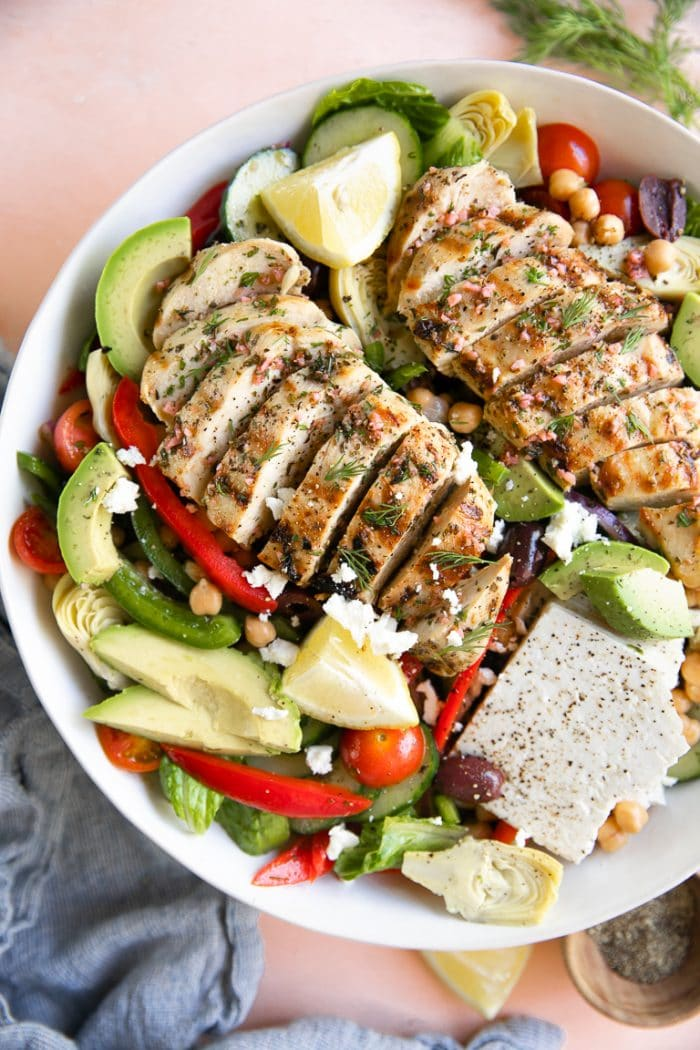 Large salad bowl filled with Greek chicken salad.