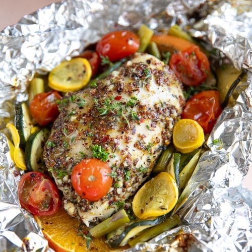 Honey Dijon Chicken Foil Packets with chopped vegetables.