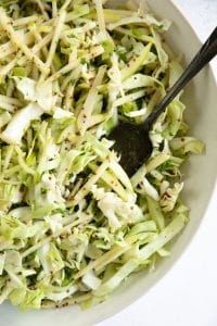 Tossed together crunchy apple coleslaw dressed with a light dijon vinaigrette.