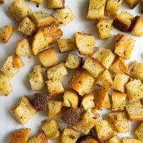 Perfectly toasted croutons on a large baking sheet.
