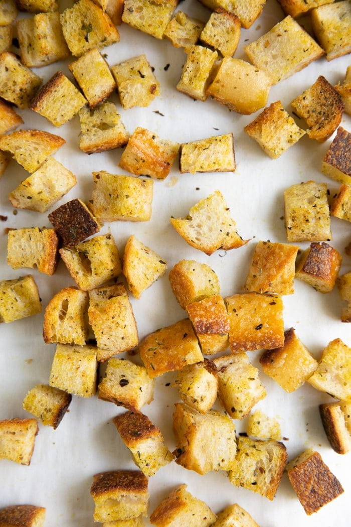 Baking sheet filled with homemade toasted croutons.