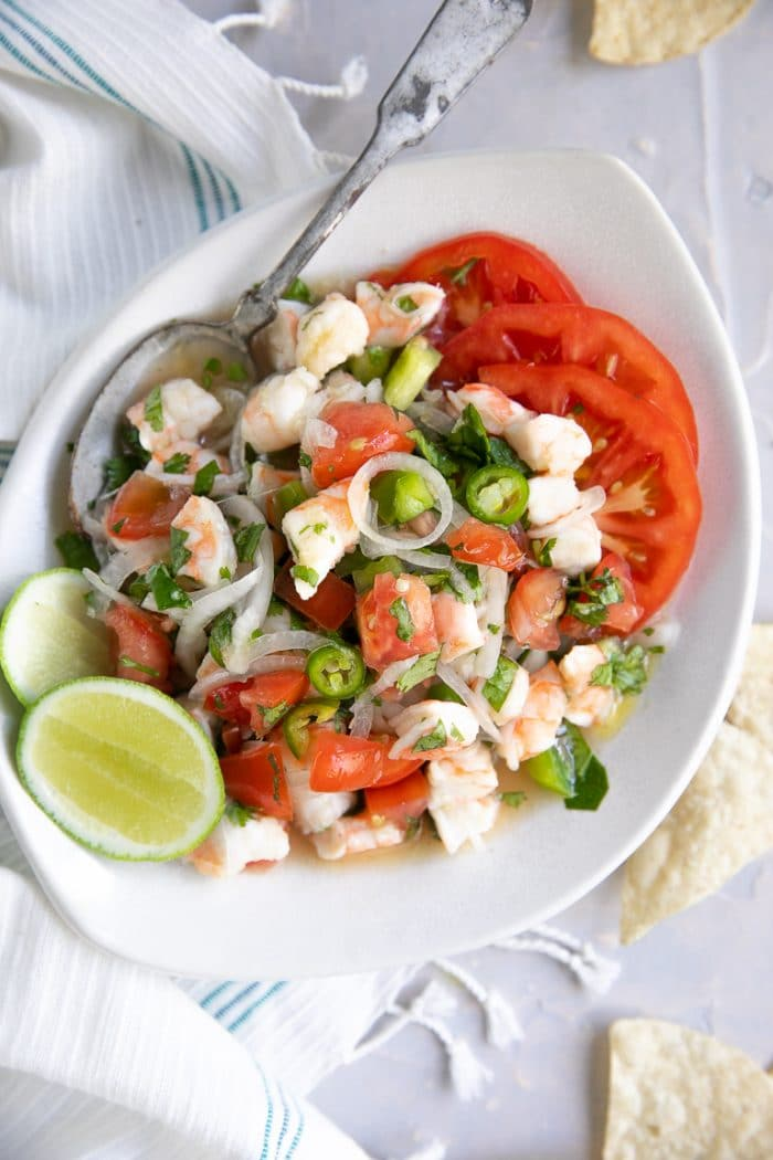 Overhead image of a white serving dish filled with fresh shrimp ceviche.