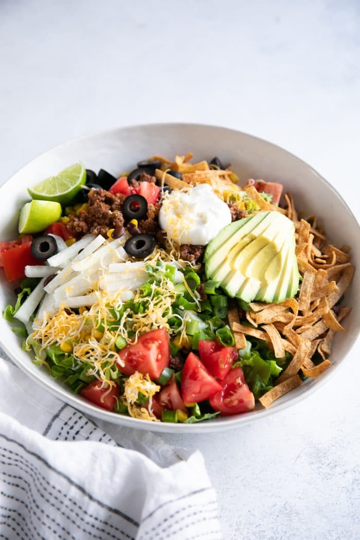 Large white bowl filled with taco salad.