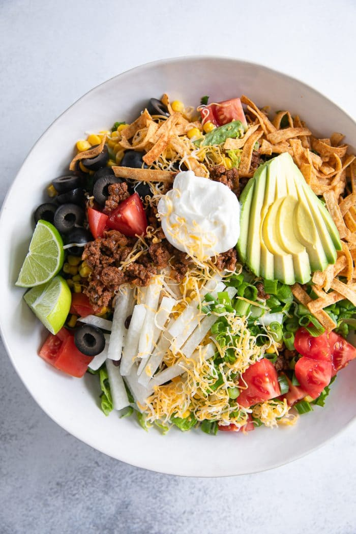The ultimate taco salad in a large white bowl.