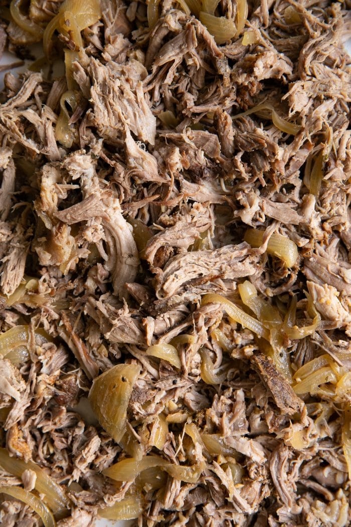 Close up overhead image of shredded apple cider pulled pork.