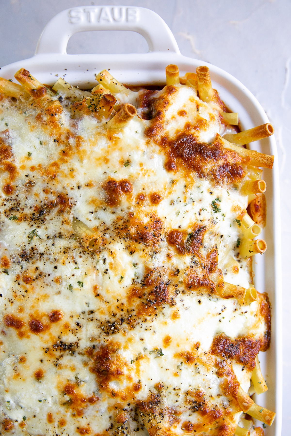 A baked ziti dish covered in cheese