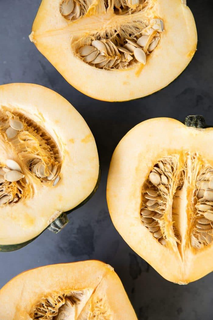 Four acorn squash halves.