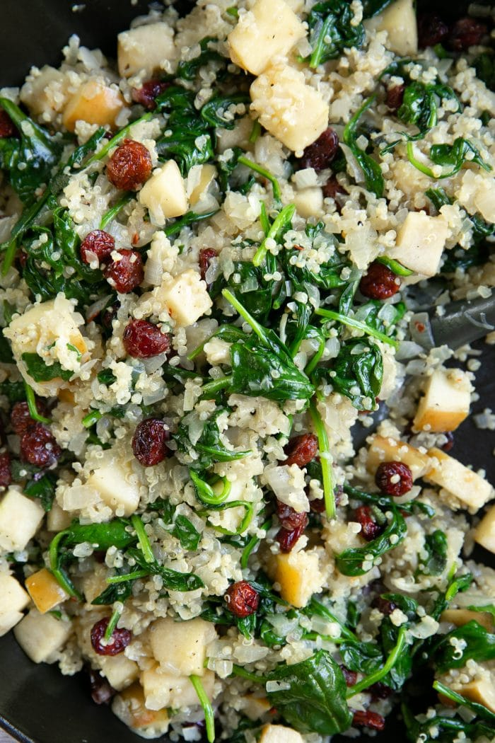 Sauteed baby spinach, quinoa, parmesan cheese, apples, dried cranberries, sage, and onions.
