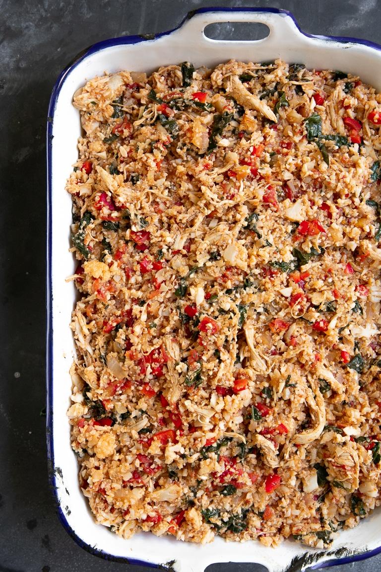 A Casserole dish filled with chicken Caprese casserole