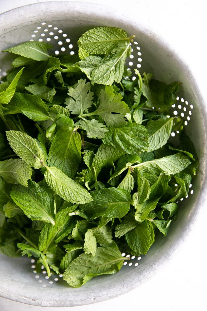 Fresh mint leaves in a colander.