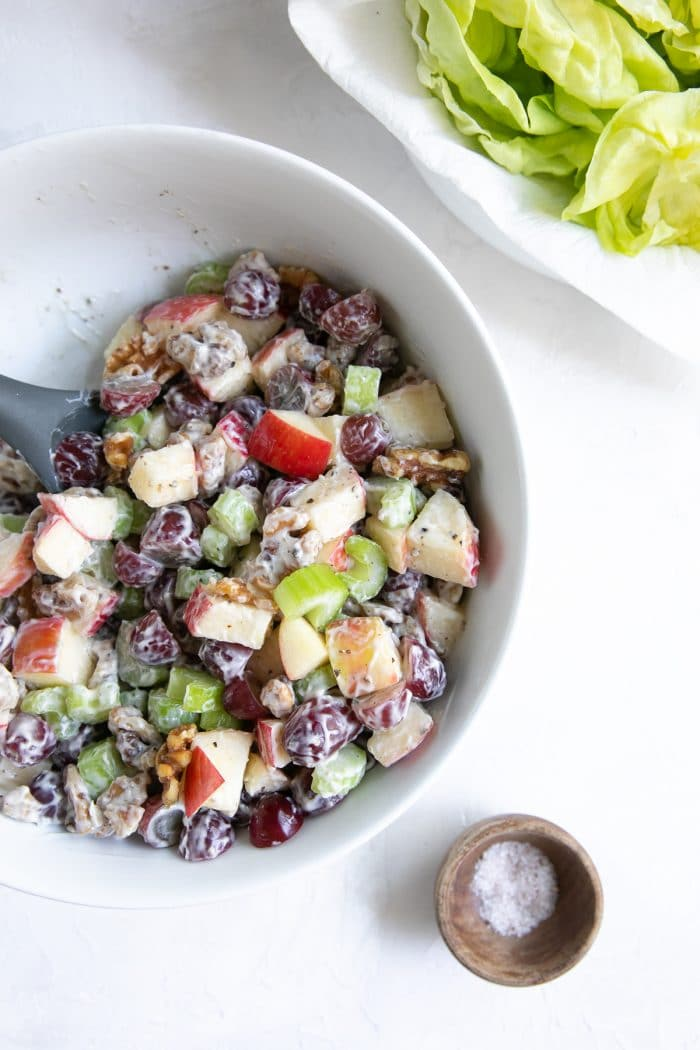 Salad made with diced apples, grapes, walnuts, and chopped celery, tossed in mayonnaise