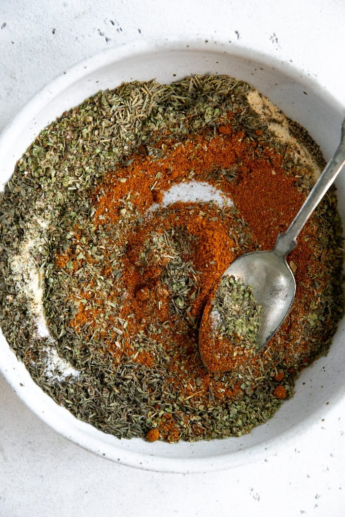 Shallow bowl filled with herbs and spices for chicken and poultry.