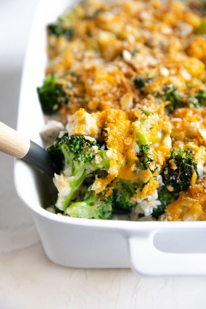 Cooked Chicken Broccoli Rice Casserole in a white casserole dish.
