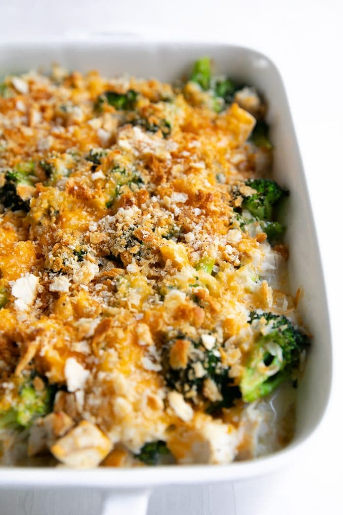 Chicken Broccoli Rice Casserole topped with buttery crushed crackers and shredded cheddar cheese.