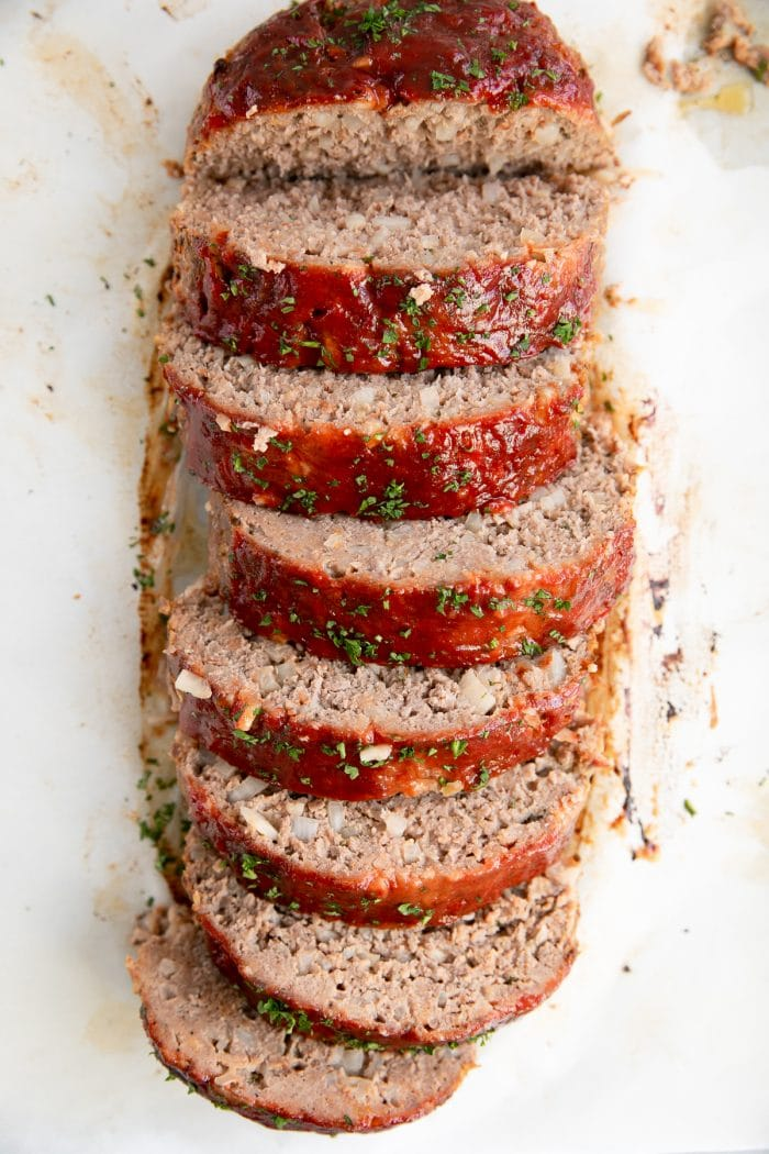 Overhead image of sliced beef meatloaf recipe.