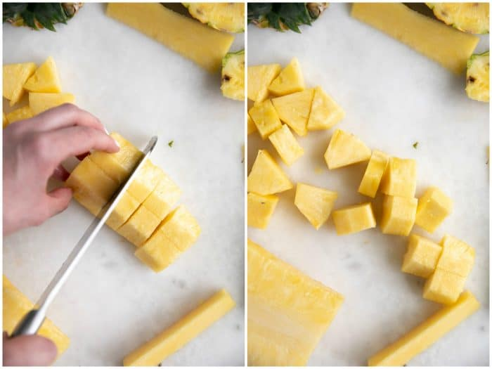 Cutting a pineapple into small chunks.