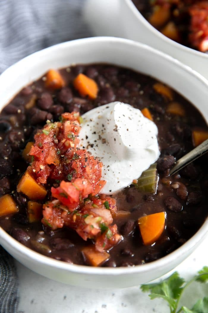 White bowl filled with easy black bean soup recipe.
