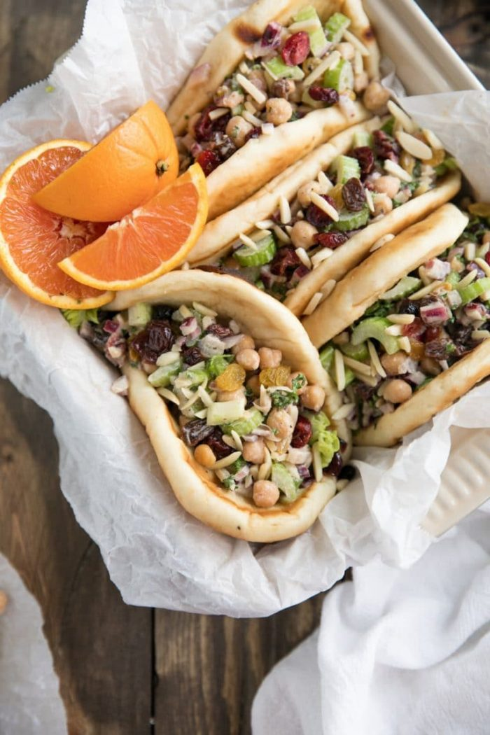 Soft naan bread stuffed with chickpeas, avocado, celery, and raisins.
